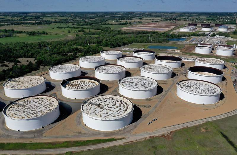 CUSHING, OKLAHOMA - APRIL 23: An aerial drone view of a crude oil storage facility on April 23, 2020 in Cushing, Oklahoma. Crude oil prices plummeted into negative territory this week with the lack of demand partly due to travel restrictions currently in place across the United States due to the coronavirus (COVID-19) pandemic.   Tom Pennington/Getty Images/AFP