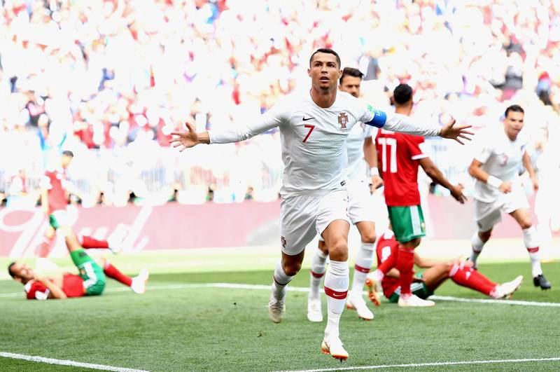 epa06824006 Cristiano Ronaldo of Portugal celebrates scoring the opening goal during the FIFA World Cup 2018 group B preliminary round soccer match between Portugal and Morocco in Moscow, Russia, 20 June 2018.  (RESTRICTIONS APPLY: Editorial Use Only, not used in association with any commercial entity - Images must not be used in any form of alert service or push service of any kind including via mobile alert services, downloads to mobile devices or MMS messaging - Images must appear as still images and must not emulate match action video footage - No alteration is made to, and no text or image is superimposed over, any published image which: (a) intentionally obscures or removes a sponsor identification image; or (b) adds or overlays the commercial identification of any third party which is not officially associated with the FIFA World Cup)  EPA/PETER POWELL   EDITORIAL USE ONLY