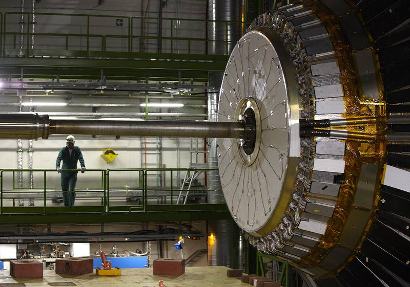 A technician stands near equipment of the Compact Muon Solenoid (CMS) experience at the Organization for Nuclear Research (CERN) in the French village of Cessy near Geneva in Switzerland April 15, 2013.  As hundreds of engineers and workers start two years of work to fit out the giant LHC particle collider to reach deep into unknown realms of nature, CERN physicists look to the vast machine to unveil by the end of the decade the nature of the mysterious dark matter that makes up a quarter of the universe and perhaps find new dimensions of space.  REUTERS/Denis Balibouse  (FRANCE - Tags: SCIENCE TECHNOLOGY)