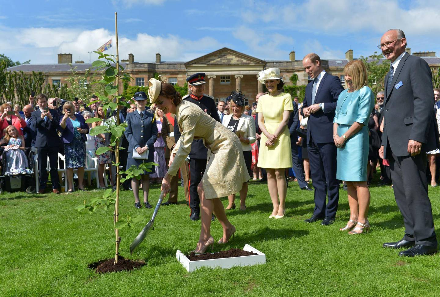 Mandatory Credit: Photo by Press Eye Ltd/Shutterstock (5731057l)Prince William and Catherine Duchess of Cambridge plant a tree at the Royal Garden Party at Hillsborough CastleAnnual Garden Party in Hillsborough Castle, Northern Ireland, UK - 14 Jun 2016