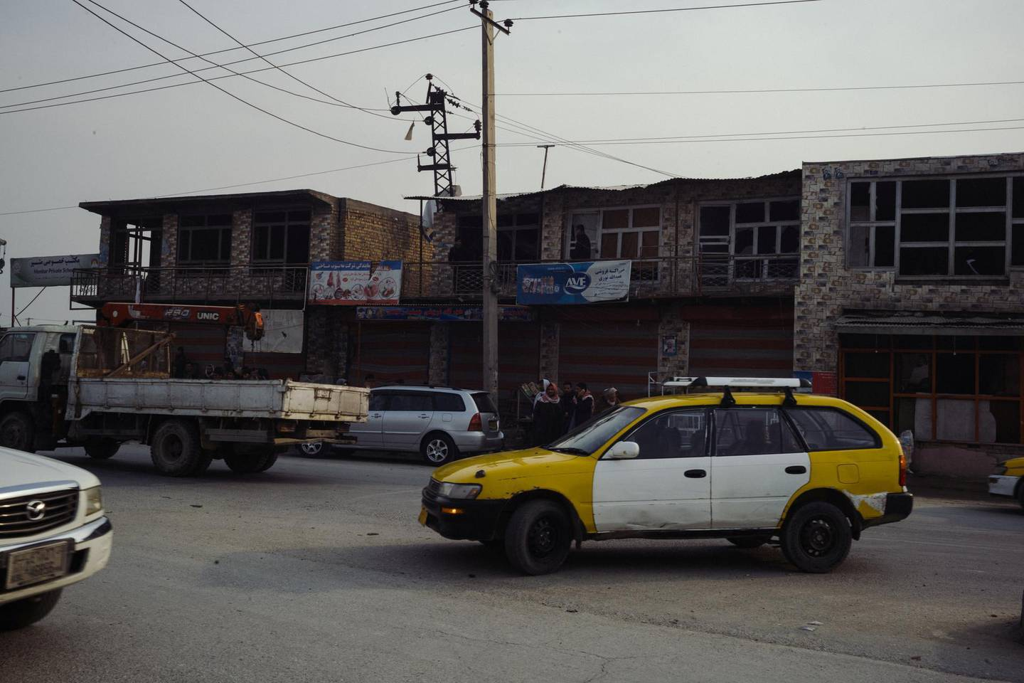January 15th, 2019 - Kabul, Kabul, Afghanistan:  Cars and Taxis drive past damaged shops and homes in the Qabil Bai district of Kabul. The shops were damaged by an explosion that targetted a foreigner compound.The attack on the Green Village, a compound in Kabul that houses foreign workers and NGO's, initially killed 9 and wounded over 120 Afghans who lived in the vicinity. There was also extensive property damage to the surrounding homes and shops. Ivan Flores/The National
