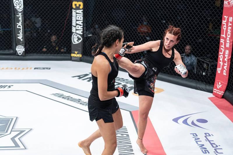 Lina Fayyad lands a high kick on Sophia Haddouche in the UAE Warriors 19 Arabia 3 at the Jiu-Jitsu Arena on Friday, June 18, 2021. Courtesy UAE Warriors
