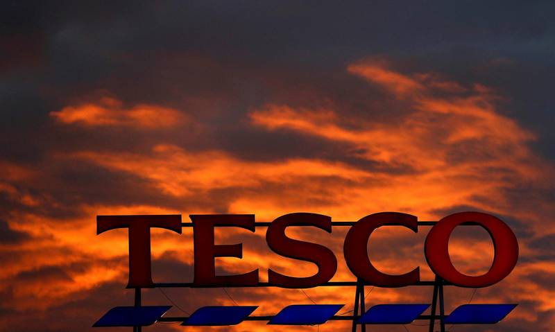 FILE PHOTO: A company logo is pictured outside a Tesco supermarket in Altrincham, Britain April 16, 2016. REUTERS/Phil Noble/File Photo