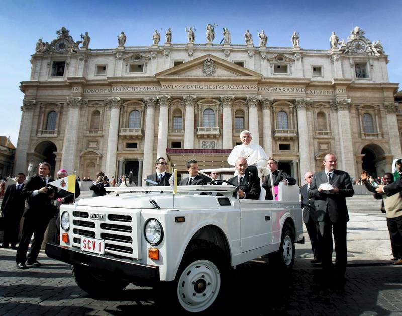 VATICAN CITY, VATICAN CITY - OCTOBER 18:  Pope Benedict XVI is seen in his Popemobile as he waves to the crowds of pilgrims as he moves around Piazza S. Pietro in his popemobile during his weekly audience on October 18, 2006 in the Vatican City, Italy  (Photo by Chris Jackson/Getty Images)
