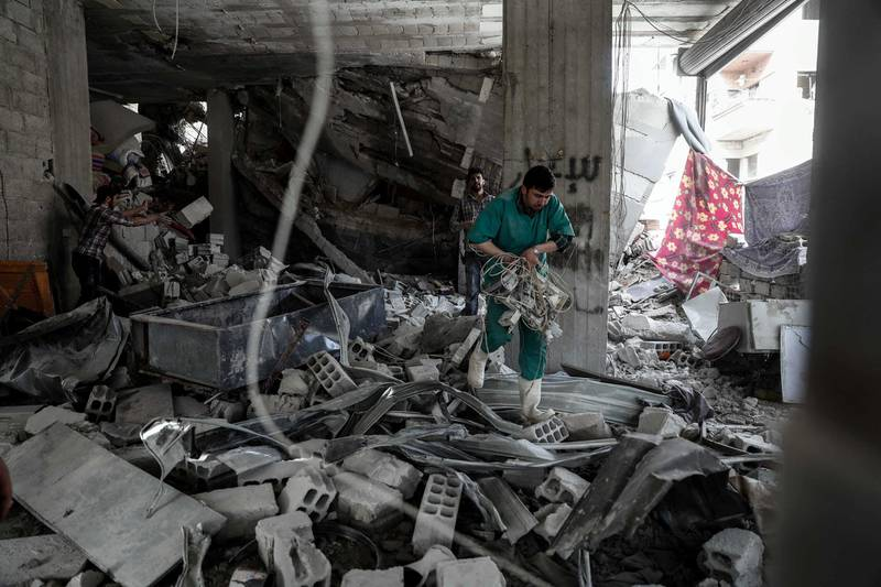 A Syrian man inspect a hospital, damaged following an air strike a rebel-controlled town in the eastern Ghouta region on the outskirts of the capital Damascus on May 1, 2017. (Photo by Sameer Al-Doumy / AFP)