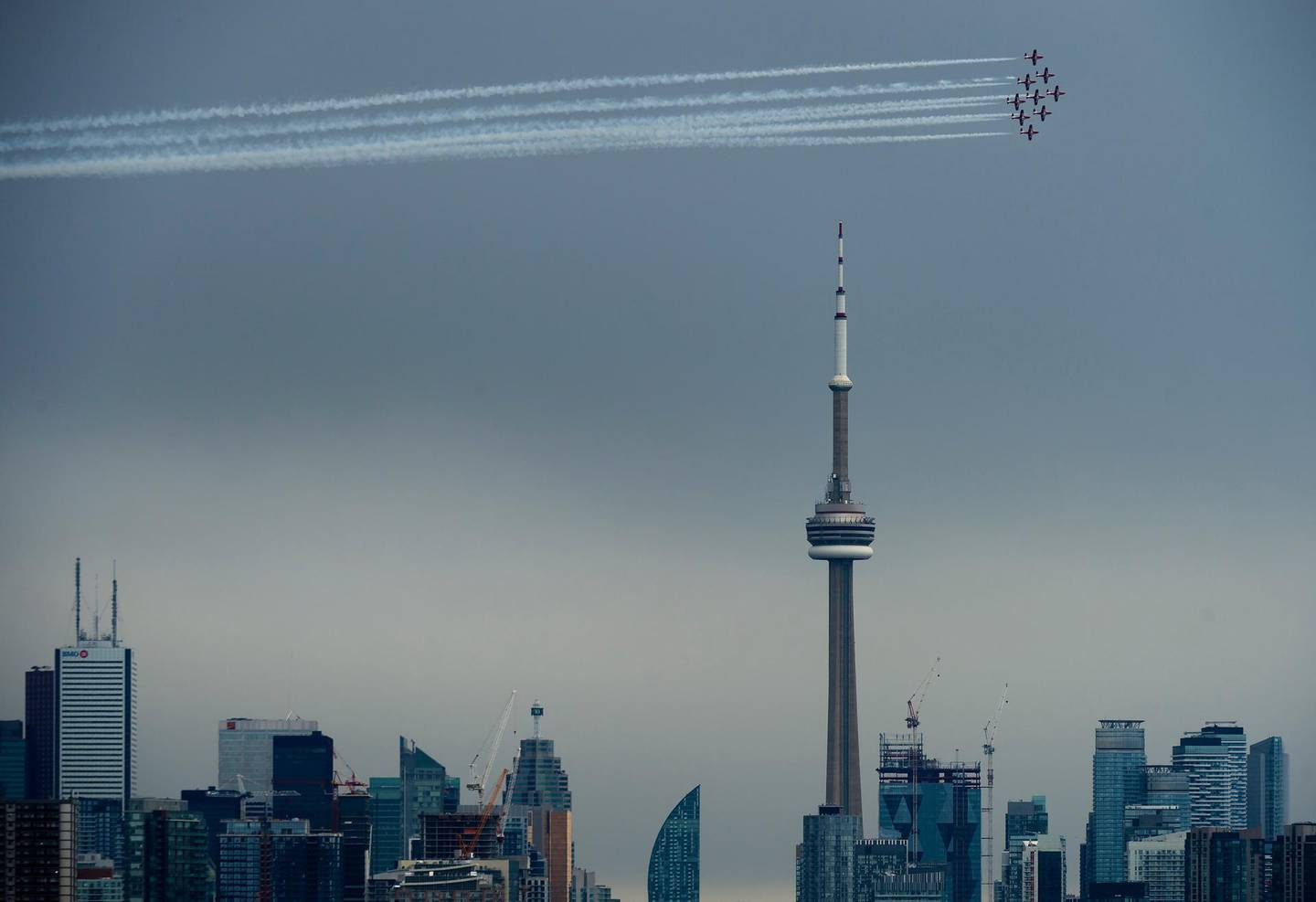 The Canadian Snowbirds circle the CN Tower as part of Operation Inspiration during the COVID-19 pandemic in Toronto, Sunday, May 10, 2020. (Nathan Denette/The Canadian Press via AP)