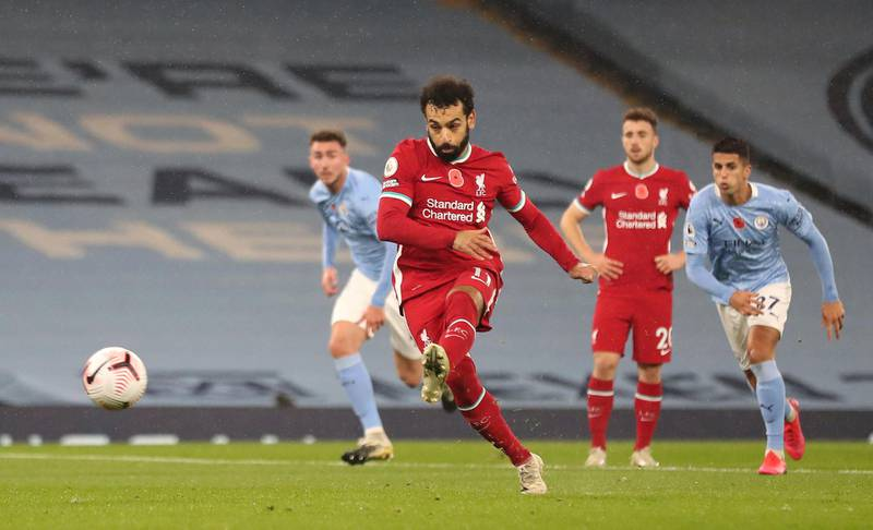 MANCHESTER, ENGLAND - NOVEMBER 08: Mohamed Salah of Liverpool scores his sides first goal from the penalty spot during the Premier League match between Manchester City and Liverpool at Etihad Stadium on November 08, 2020 in Manchester, England. Sporting stadiums around the UK remain under strict restrictions due to the Coronavirus Pandemic as Government social distancing laws prohibit fans inside venues resulting in games being played behind closed doors. (Photo by Martin Rickett - Pool/Getty Images)