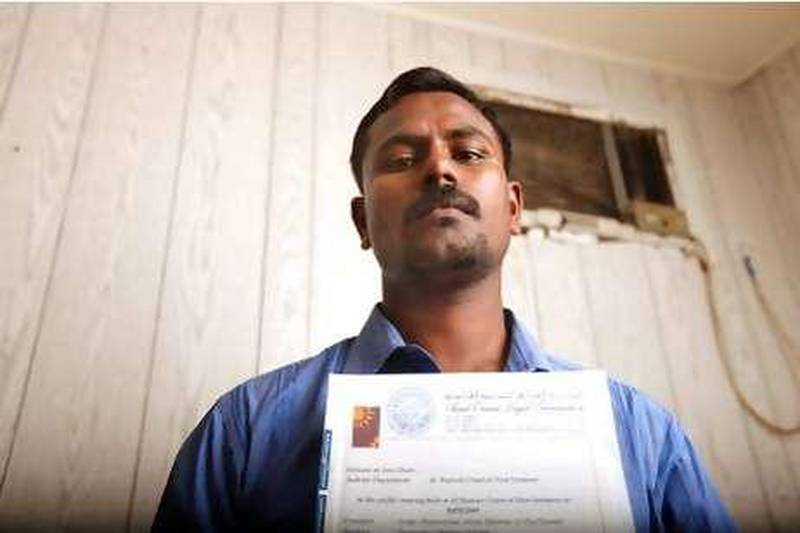 August 4, 2010/ Mussafah /  Yogaselvan Sugumaran, 29, hold up the courts judgment against him. Sugumaran is trying to pay off a 100,000dh in blood money after spending 58 days in jail August 3, 2010. Fifteen months ago the truck he was driving broke down after being picked up by another driver they hit a Bangladeshi man. Sugumaran was held responsible along with the other man even though he was not driving when the accident happened. (Sammy Dallal / The National)