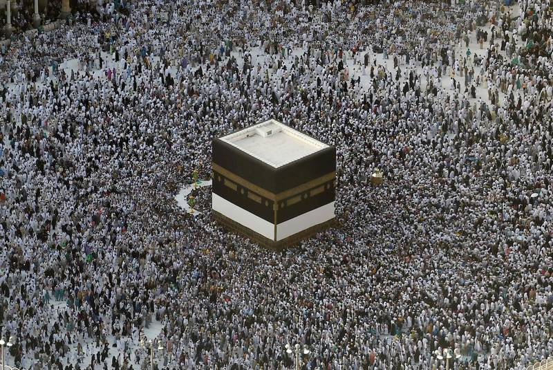 (FILES) In this file photo taken on August 8, 2019, Muslim pilgrims gather around the Kaaba, Islam's holiest shrine, at the Grand Mosque in Saudi Arabia's holy city of Mecca, prior to the start of the annual Hajj pilgrimage in the holy city. Saudi Arabia announced today it will allow 60,000 residents of the kingdom, vaccinated against the coronavirus, to perform the annual hajj, state media reported. / AFP / FETHI BELAID