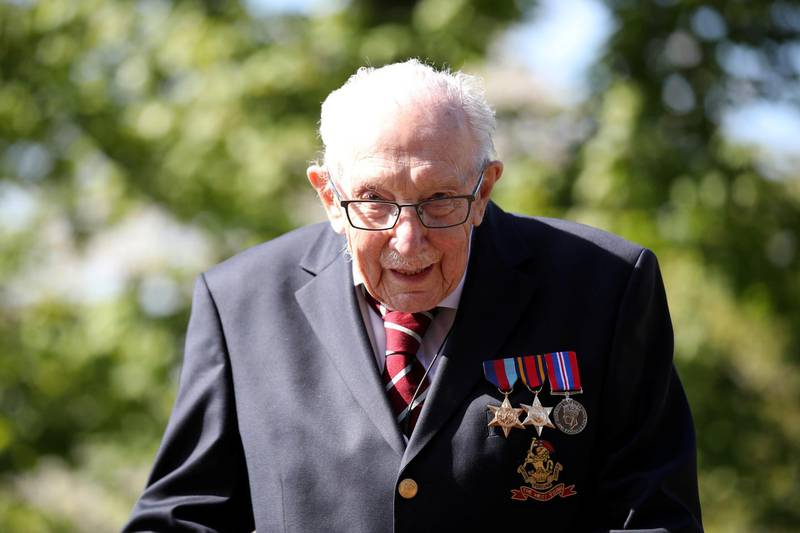 FILE PHOTO: Retired British Army Captain Tom Moore, 99, raises money for health workers by attempting to walk the length of his garden one hundred times before his 100th birthday this month as the spread of coronavirus disease (COVID-19) continues, Marston Moretaine, Britain, April 15, 2020. REUTERS/Peter Cziborra/File Photo
