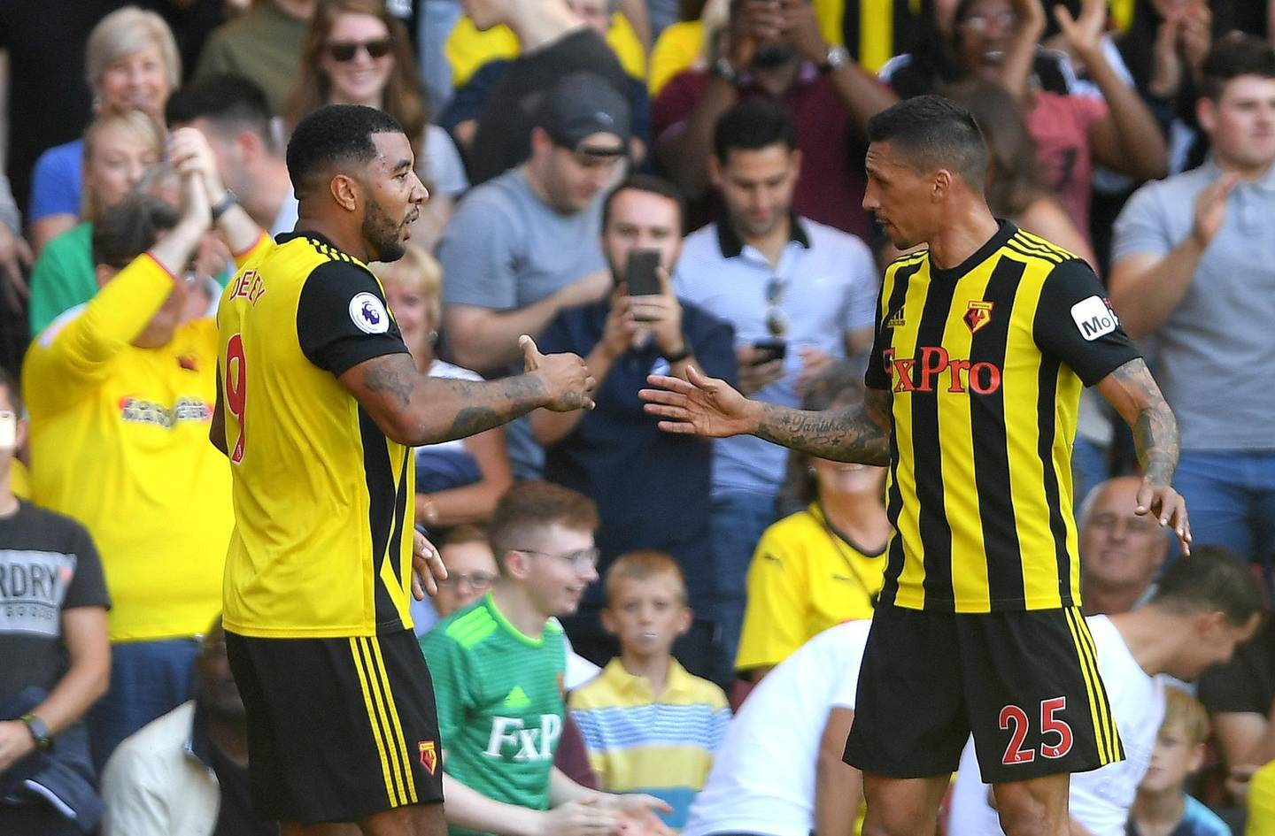 WATFORD, ENGLAND - SEPTEMBER 02:  Troy Deeney of Watford (9) celebrates as he scores his team's first goal with Jose Holebas of Watford (25) during the Premier League match between Watford FC and Tottenham Hotspur at Vicarage Road on September 2, 2018 in Watford, United Kingdom.  (Photo by Mike Hewitt/Getty Images)