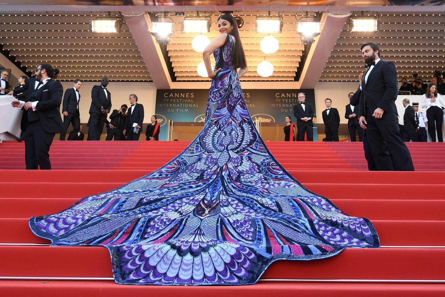 """TOPSHOT - Indian actress Aishwarya Rai Bachchan poses as she arrives on May 12, 2018 for the screening of the film """"Girls of the Sun (Les Filles du Soleil)"""" at the 71st edition of the Cannes Film Festival in Cannes, southern France.  / AFP / Loic VENANCE"""