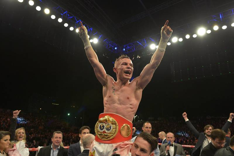 BELFAST, NORTHERN IRELAND - SEPTEMBER 6: The new IBF super-bantamweight world champion Carl Frampton of Northern Ireland celebrates after his victory over Kiko Martinez of Spain, at the purpose-built 16,000 capacity Titanic slipway outdoor arena on September 6, 2014 in Belfast, Northern Ireland. (Photo by Charles McQuillan/Getty Images).