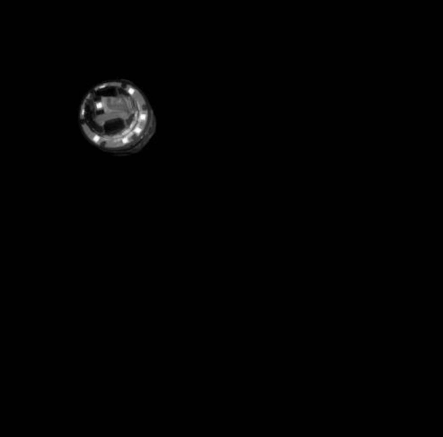 """This image released by the Japan Aerospace Exploration Agency (JAXA) shows an explosive dropped from Hayabusa2 spacecraft to make a crater on the asteroid Ryugu Friday, April 5, 2019. Japan's space agency JAXA said its Hayabusa2 spacecraft successfully dropped the """"small carry-on impactor"""" made of copper onto the asteroid and collect its underground samples to find possible clues to the origin of the solar system. (JAXA via AP)"""