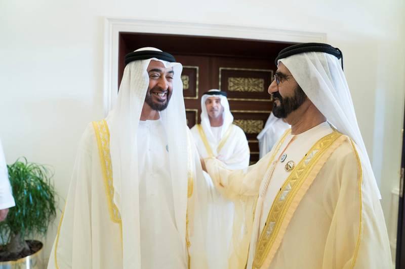 ABU DHABI, UNITED ARAB EMIRATES - June 15, 2018: HH Sheikh Mohamed bin Zayed Al Nahyan Crown Prince of Abu Dhabi Deputy Supreme Commander of the UAE Armed Forces (L), receives HH Sheikh Mohamed bin Rashid Al Maktoum, Vice-President, Prime Minister of the UAE, Ruler of Dubai and Minister of Defence (R), during an Eid Al Fitr reception at Mushrif Palace.    ( Mohamed Al Hammadi / Crown Prince Court - Abu Dhabi ) ---