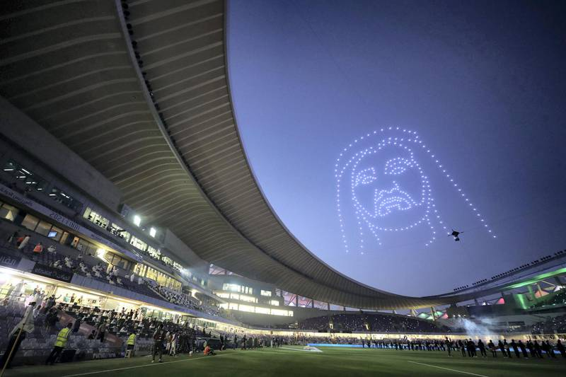 Drones light up the sky with the face of Sheikh Mohammed bin Rashid before the game between Shabab Al Ahli and Al Nasr in the PresidentÕs Cup final in Al Ain on May 16th, 2021. Chris Whiteoak / The National.  Reporter: John McAuley for Sport