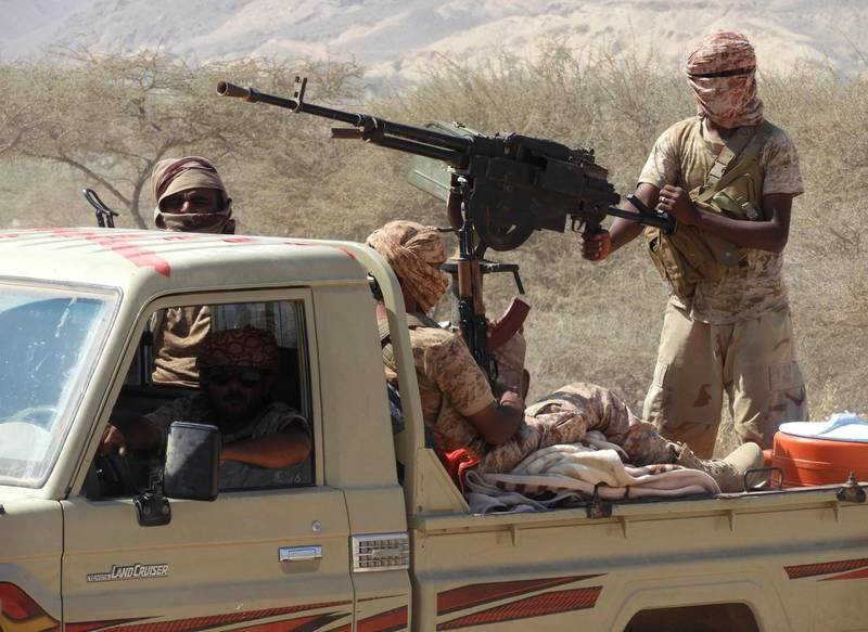 """Yemeni fighters loyal to the government backed by the Saudi-led coalition fighting in the country ride in the back of a pickup truck with mounted heavy machine gun while closing in on a suspected location of an Al-Qaeda in the Arabian Peninsula (AQAP) leader during their the offensive in the Mesini Valley in the vast province of Hadramawt on February 21, 2018. Yemeni special forces trained by the United Arab Emirates -- a key member of a Saudi-led alliance fighting alongside Yemen's government forces -- had in the previous week launched the offensive, codenamed """"Al-Faisal"""", against Al-Qaeda cells in oil-rich Hadramawt province. Two soldiers were killed on February 17 in the offensive, which targets the Mesini and Amed Valleys in Hadramawt and which are critical in the control over Yemen's southeastern coastline. / AFP PHOTO / SALEH AL-OBEIDI"""