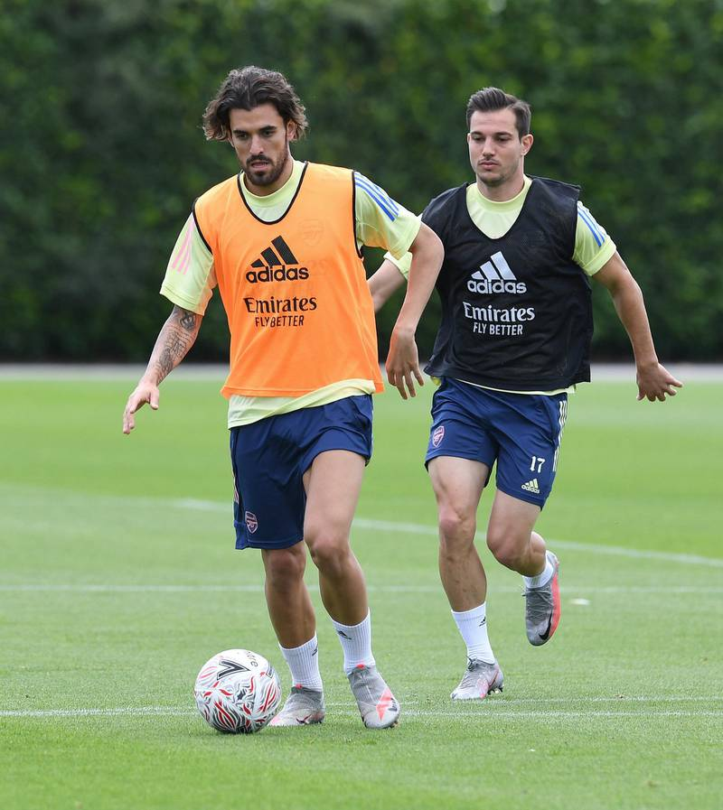 ST ALBANS, ENGLAND - JULY 29: (L-R) Dani Ceballos and Cedric of Arsenal during a training session at London Colney on July 29, 2020 in St Albans, England. (Photo by Stuart MacFarlane/Arsenal FC via Getty Images)