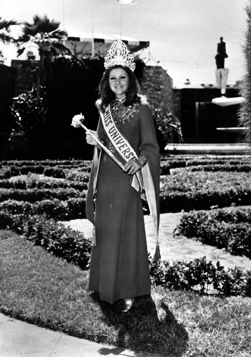 Georgia Risk, Miss Universe 1971, poses with the official Miss Universe crown, sash and sceptor. Miss Universe no longer receives the sceptor, but she still receives a crown, sash and prize package that includes scholarships, jewelry, watches, clothing, and more. Courtesy Miss Universe