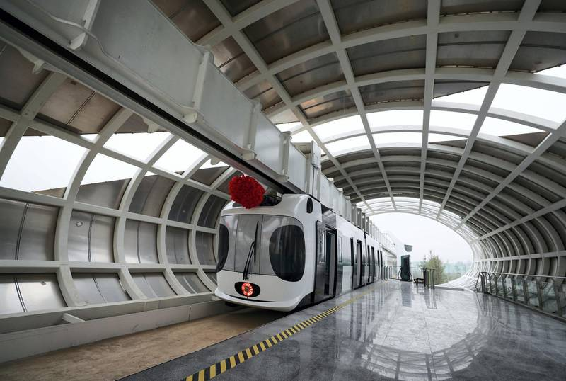 Mandatory Credit: Photo by Xinhua/Shutterstock (7450143g)A train suspended from a railway line parks at a station in Chengdu, capital of southwest China's Sichuan ProvinceSuspension railway line, Chengdu, Sichuan Province, China - 21 Nov 2016After two months of tests, China's first suspension railway line met all designed requirements and it is ready for more systematic operations.