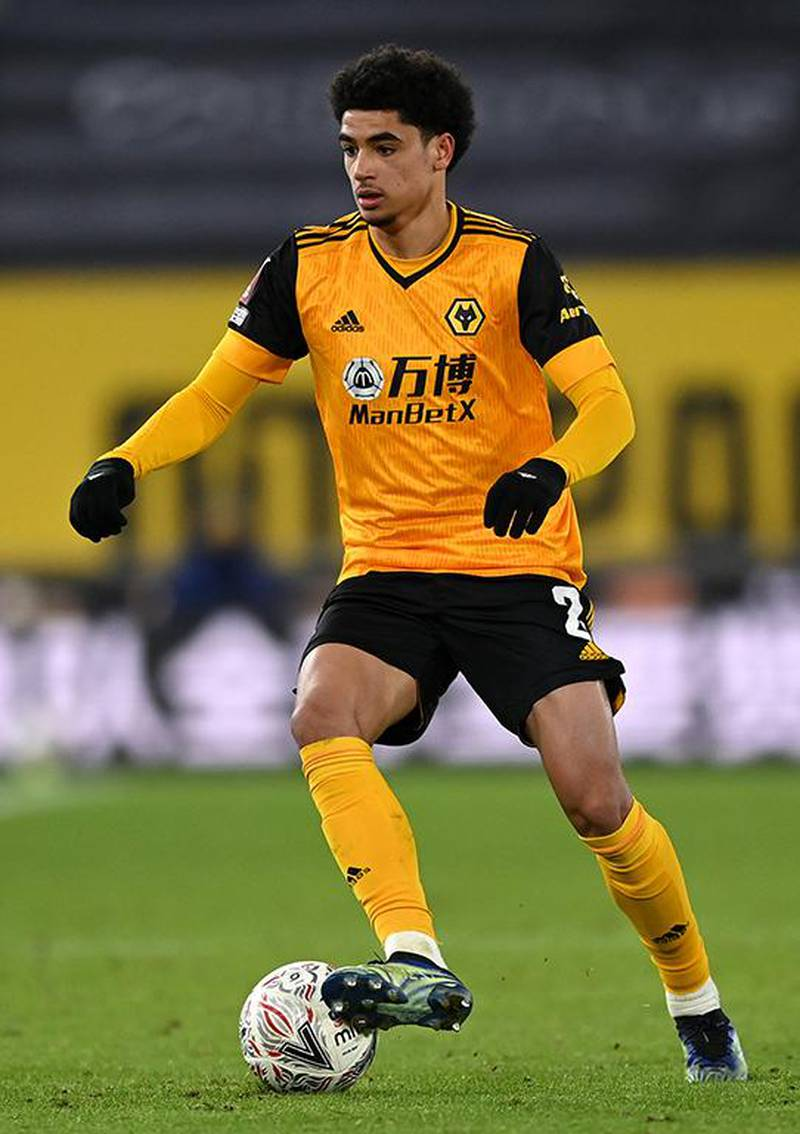 WOLVERHAMPTON, ENGLAND - FEBRUARY 11: Ki-Jana Hoever of Wolverhampton Wanderers controls the ball during The Emirates FA Cup Fifth Round match between Wolverhampton Wanderers and Southampton at Molineux on February 11, 2021 in Wolverhampton, England. Sporting stadiums around the UK remain under strict restrictions due to the Coronavirus Pandemic as Government social distancing laws prohibit fans inside venues resulting in games being played behind closed doors. (Photo by Shaun Botterill/Getty Images)