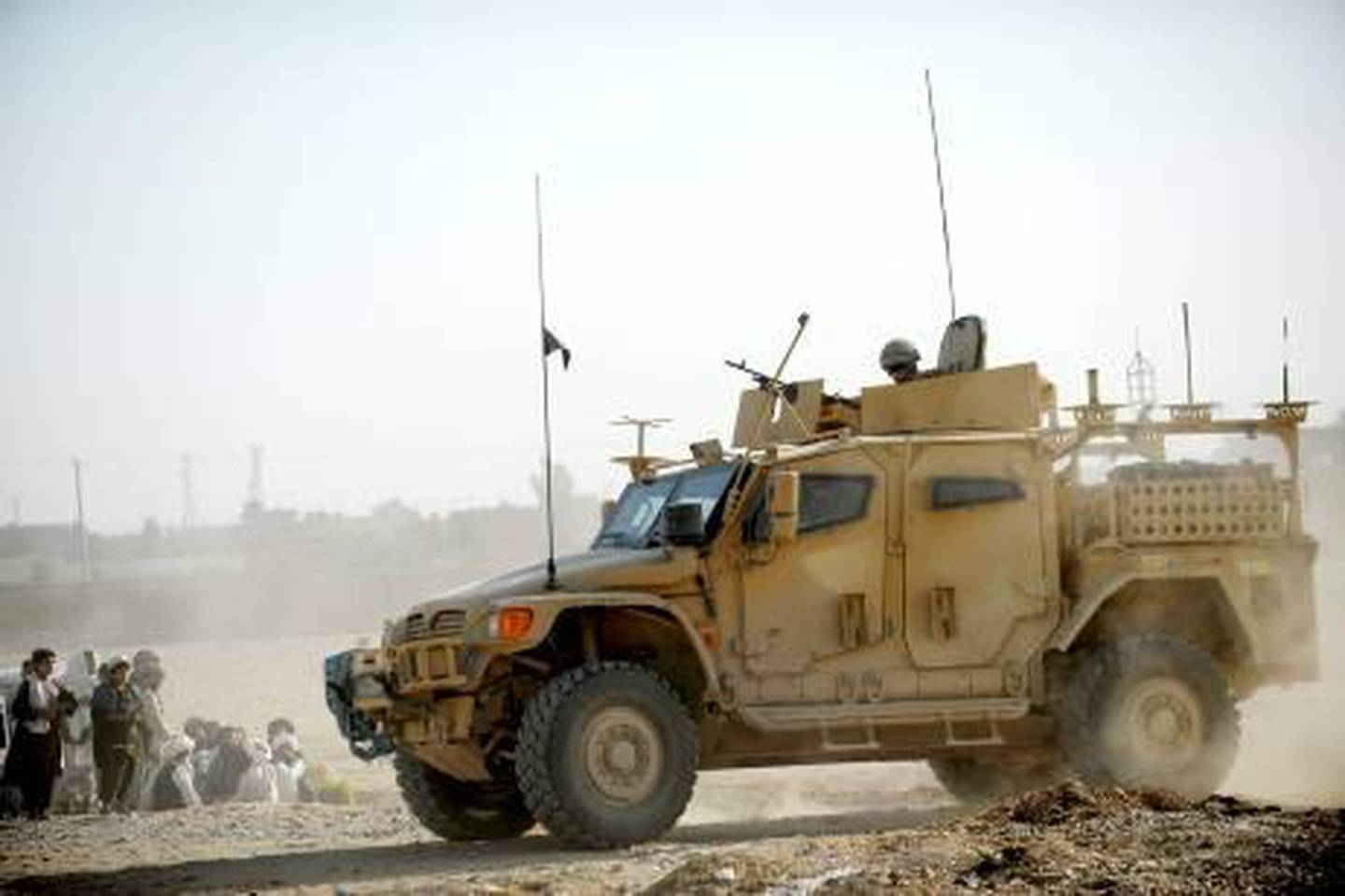 British Army troops from 1st Battalion, The Scots Guards, patrol using the new Husky armoured vehicle in Lashkar Gar, Helmand province, Afghanistan in a picture released October 17, 2010. Britain's defence budget will be cut by less than 10 percent over the next four years after officials reached an agreement late on Friday on the outline of a sweeping review of the country's armed forces.  REUTERS/Sgt Rupert Frere/Crown Copyright/handout   (AFGHANISTAN - Tags: MILITARY CIVIL UNREST) THIS IMAGE HAS BEEN SUPPLIED BY A THIRD PARTY. IT IS DISTRIBUTED, EXACTLY AS RECEIVED BY REUTERS, AS A SERVICE TO CLIENTS. NO SALES. NO ARCHIVES. FOR EDITORIAL USE ONLY. NOT FOR SALE FOR MARKETING OR ADVERTISING CAMPAIGNS *** Local Caption ***  CLH104_BRITAIN-DEFE_1017_11.JPG