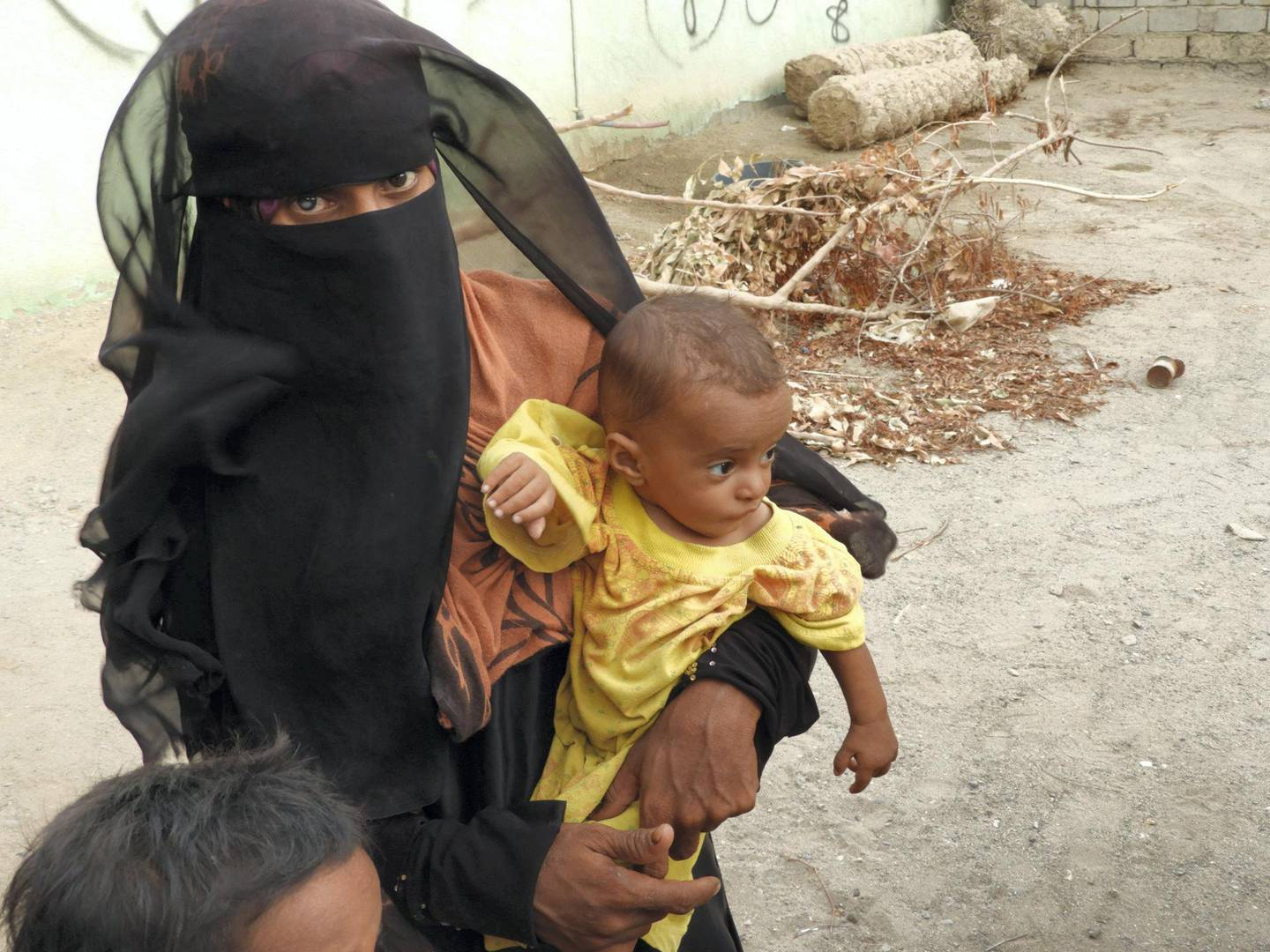 The woman with her baby. Ali Mahmood Mohamed for The National