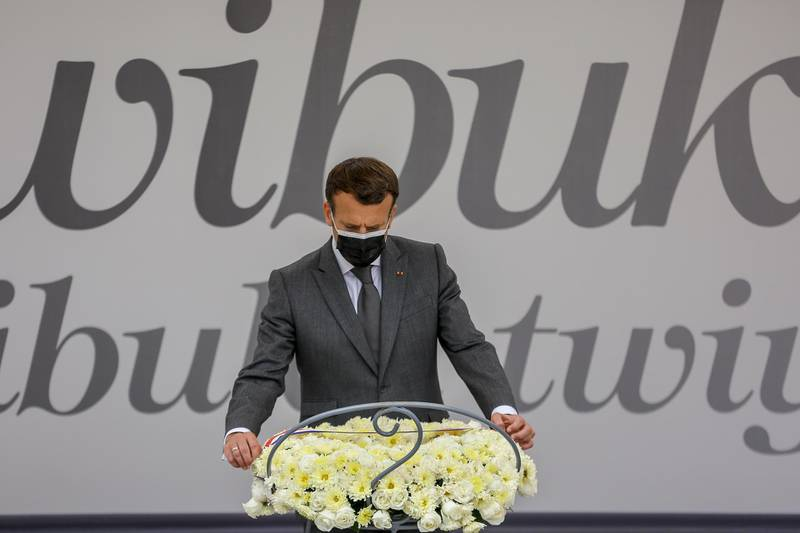 French President Emmanuel Macron lays a wreath at the genocide memorial site in the capital Kigali, Rwanda Thursday, May 27, 2021. In a key speech on his visit to Rwanda, Macron said he recognizes that France bears a heavy responsibility for the 1994 genocide in the central African country. (AP Photo/Muhizi Olivier)