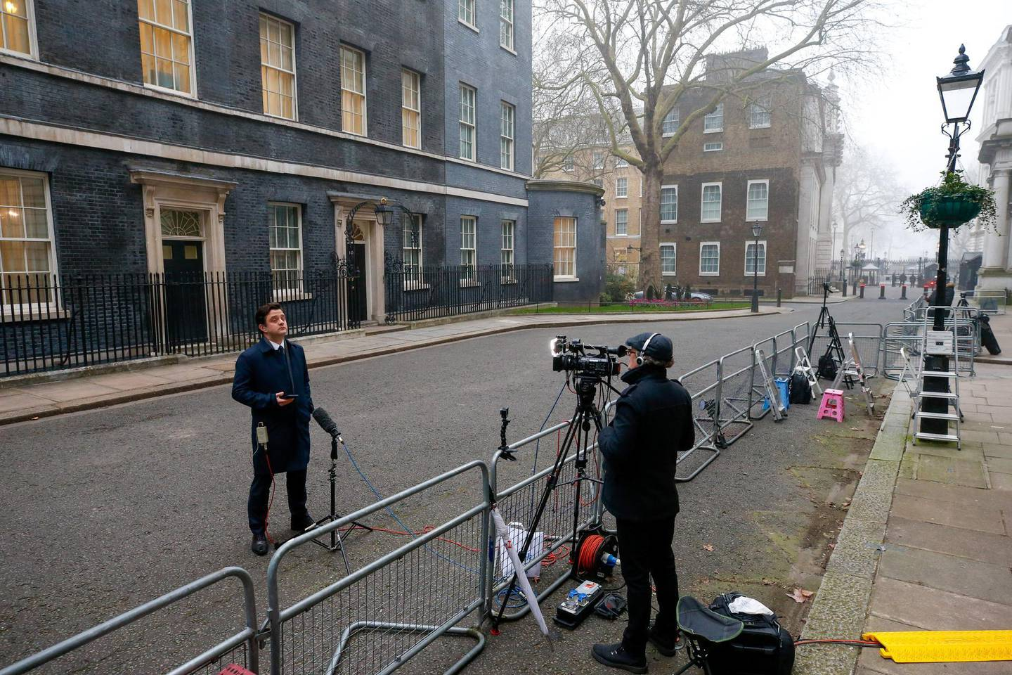 A television journalist stands outside 10 Downing Street ahead of Rishi Sunak, U.K. chancellor of the exchequer, presenting the budget statement in Parliament in London, U.K., on Wednesday, March 3, 2021. Sunakwill extend furlough payments to U.K. workers until the end of September, protecting millions of people whose jobs were suspended during the coronavirus pandemic until after restrictions are set to be lifted. Photographer: Hollie Adams/Bloomberg
