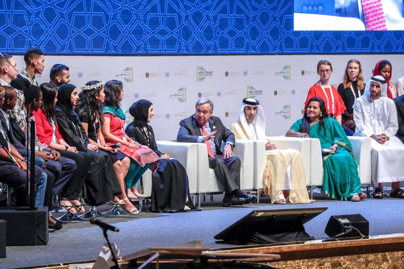 Abu Dhabi, United Arab Emirates, June 30, 2019.   Abu Dhabi Climate Meeting at the Emirates Palace.-- Minister of State for Houth, H.E. Shamma Al Mazrui with World Youth representatives talk to His Excellency Dr. Thani bin Ahmed Al Zeyoudi, Minister of Climate Change and Environment and António Guterres, Secretary General of the United Nationson stage regarding climate change.Section:  NAReporter:  John Dennehy