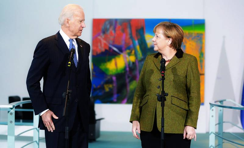 BERLIN, GERMANY - FEBRUARY 1:  U.S. Vice President Joe Biden and German Chancellor Angela Merkel speak to the media prior to talks at the Chancellery on February 1, 2013 in Berlin, Germany. The two are meeting ahead of the Munich Security Conference, which takes place from February 1-3. (Photo by Christian Marquardt-Pool/Getty Images)