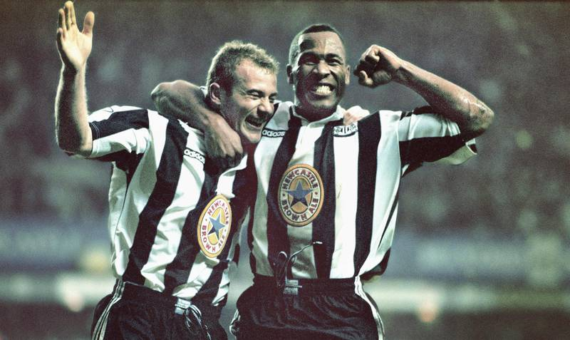 NEWCASTLE UPON-TYNE, UNITED KINGDOM - OCTOBER 20: Newcastle strikers Alan Shearer (l) and Les Ferdinand celebrate the fourth goal scored by Shearer during the Premier League match between Newcastle United and Manchester United at St Jame's Park on October 20, 1996 in Newcastle, England, Newcastle won the game 5-0. (Photo by Ben Radford/Allsport/Getty Images/Hulton Archive)