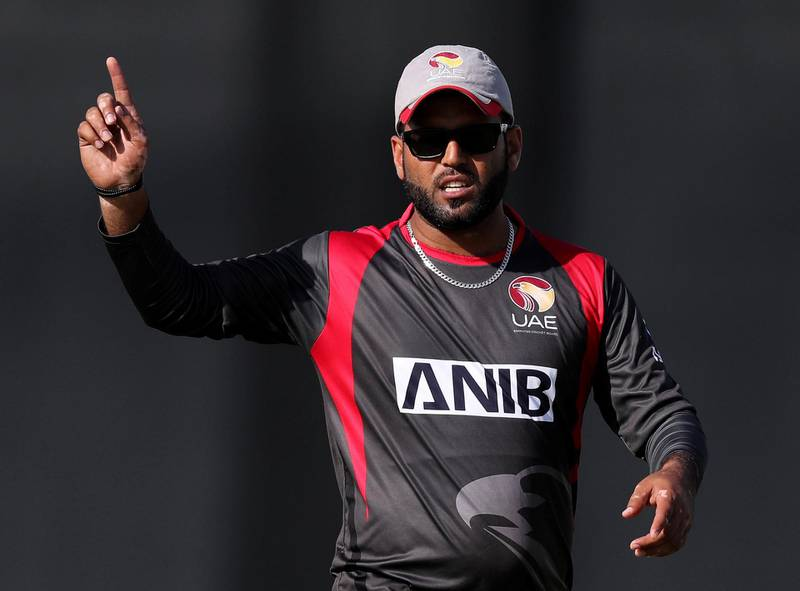 Dubai, United Arab Emirates - January 31, 2019: UAE's captain Mohammad Naveed directs his field in the the match between the UAE and Nepal in an international T20 series. Thursday, January 31st, 2019 at ICC, Dubai. Chris Whiteoak/The National