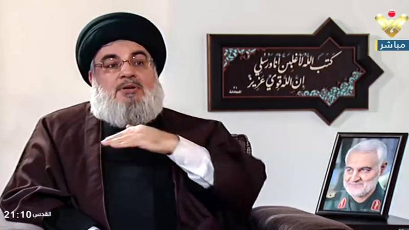 epa08906905 A video grab taken from Hezbollah's al-Manar TV shows Hezbollah leader Sayyed Hassan Nasrallah during an interview with Al Mayadeen TV  in Beirut, Lebanon, 27 December 2020. Nasrallah spoke about the political situation in the Arab region after several countries started normalizing relations with Israel, about his relationship with the Iranian commander Suleimani, among other things.  EPA/AL-MANAR TV / HANDOUT  HANDOUT EDITORIAL USE ONLY/NO SALES