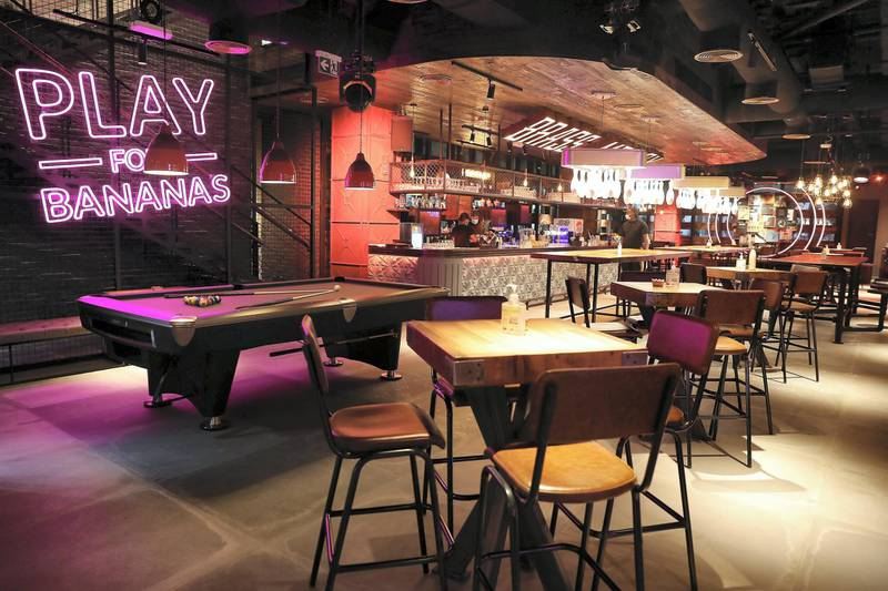 DUBAI, UNITED ARAB EMIRATES , September 27 – 2020 :- View of the restaurant on the ground floor at the Brass Monkey, new dining and entertainment destination on the Bluewaters Island in Dubai.  (Pawan Singh / The National) For Lifestyle/Online/Instagram. Story by Janice Rodrigues