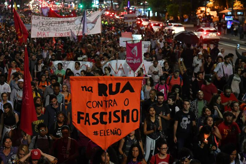 Demonstrators take part in a protest against Brazilian right-wing presidential candidate Jair Bolsonaro in Sao Paulo, Brazil, on October 10 2018. The populist ultra-conservative won 46 percent of the vote in the first round, despite detractors highlighting his contentious past comments demeaning women and gays, and speaking in favor of torture and Brazil's 1964-1985 military dictatorship. Brazil will hold the run-off presidential election next October 28. / AFP / NELSON ALMEIDA