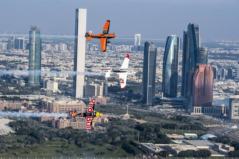 Matthias Dolderer of Germany leads Martin Sonka of Czech Republic and Nicolas Ivanoff of France along the skyline of the city of Abu Dhabi before the first stage of the Red Bull Air Race World Championship, United Arab Emirates on February 6, 2017. // Predrag Vuckovic/Red Bull Content Pool // P-20170207-00378 // Usage for editorial use only // Please go to www.redbullcontentpool.com for further information. //