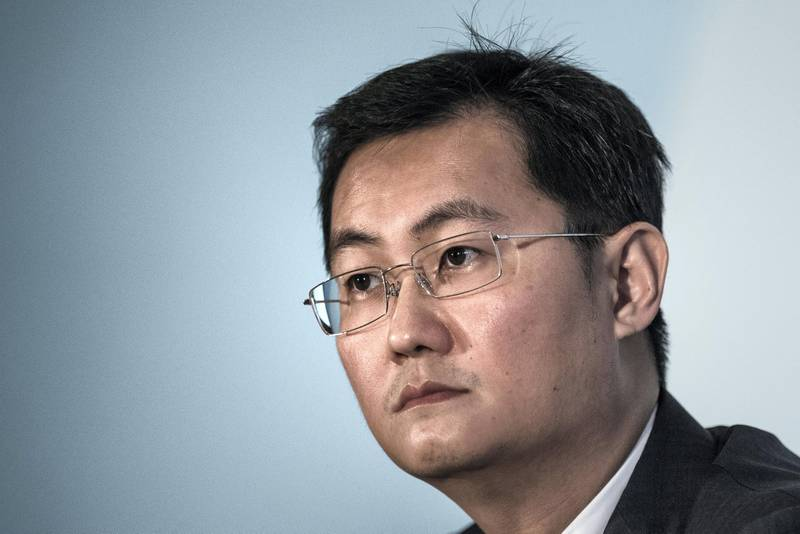 """China Internet giant Tencent Holdings CEO Ma Huateng looks on during the announcement of the company's fourth-quarter results in Hong Kong on March 18, 2015. Tencent said its net profit was up 54 percent at 3.82 billion USD (23.81 billion yuan) in 2014 helped by """"rapid development"""" of mobile gaming and social networking. AFP PHOTO / Philippe Lopez / AFP PHOTO / PHILIPPE LOPEZ"""
