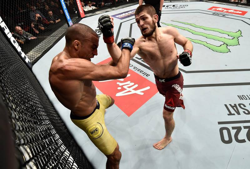 LAS VEGAS, NV - DECEMBER 30:  (R-L) Khabib Nurmagomedov of Russia punches Edson Barboza of Brazil in their lightweight bout during the UFC 219 event inside T-Mobile Arena on December 30, 2017 in Las Vegas, Nevada. (Photo by Jeff Bottari/Zuffa LLC/Zuffa LLC via Getty Images)