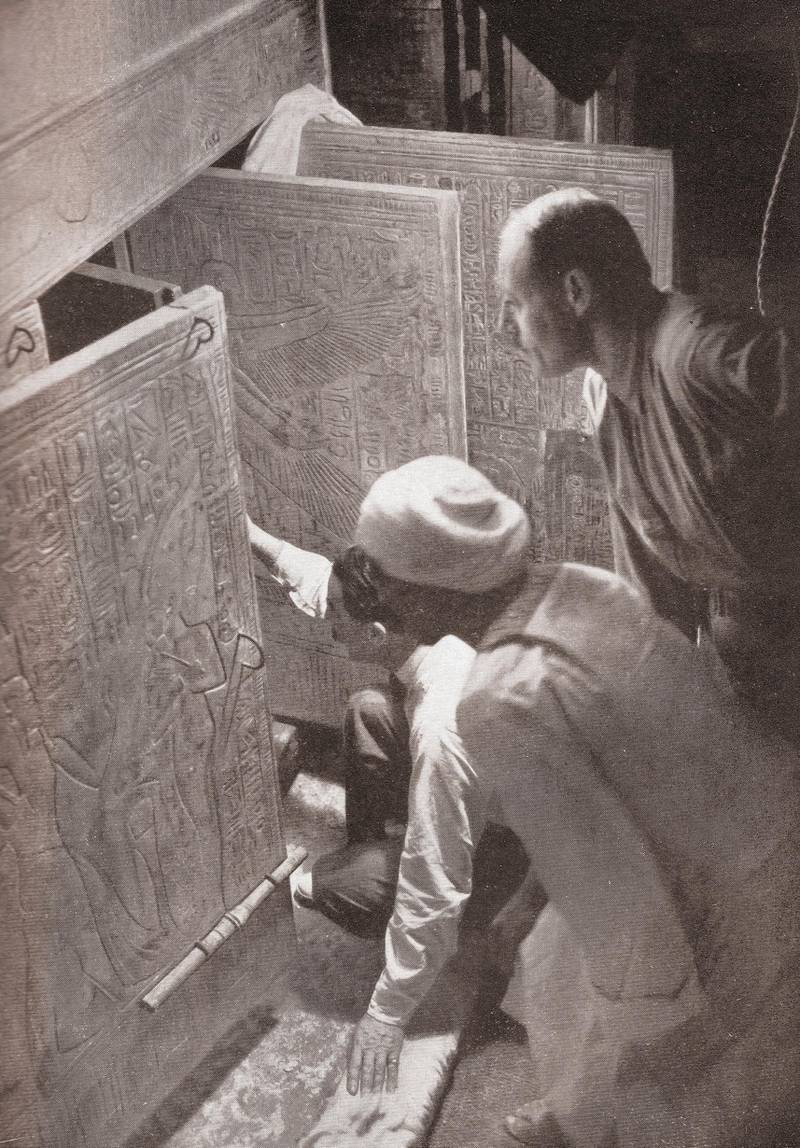 Howard Carter and associates opening the doors of King Tutankhamun's burial shrine in the Valley of the Kings, Egypt; screen print from a photograph, 1923. (Photo by GraphicaArtis/Getty Images)