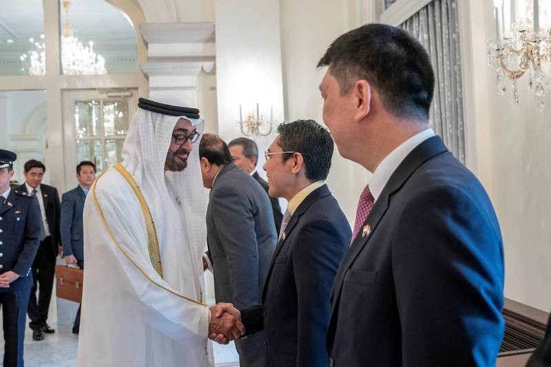 SINGAPORE, SINGAPORE - February 28, 2019: HH Sheikh Mohamed bin Zayed Al Nahyan, Crown Prince of Abu Dhabi and Deputy Supreme Commander of the UAE Armed Forces (2nd L) greets a member of the Singaporean delegation during a reception, at the Istana presidential palace. ( Mohamed Al Hammadi / Ministry of Presidential Affairs ) ---