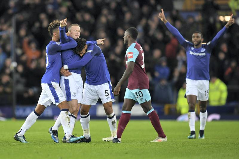 Everton's English striker Wayne Rooney (2L) celebrates scoring his third goal to complete his hattrick during the English Premier League football match between Everton and West Ham United at Goodison Park in Liverpool, north west England on November 29, 2017. / AFP PHOTO / Paul ELLIS / RESTRICTED TO EDITORIAL USE. No use with unauthorized audio, video, data, fixture lists, club/league logos or 'live' services. Online in-match use limited to 75 images, no video emulation. No use in betting, games or single club/league/player publications.  /