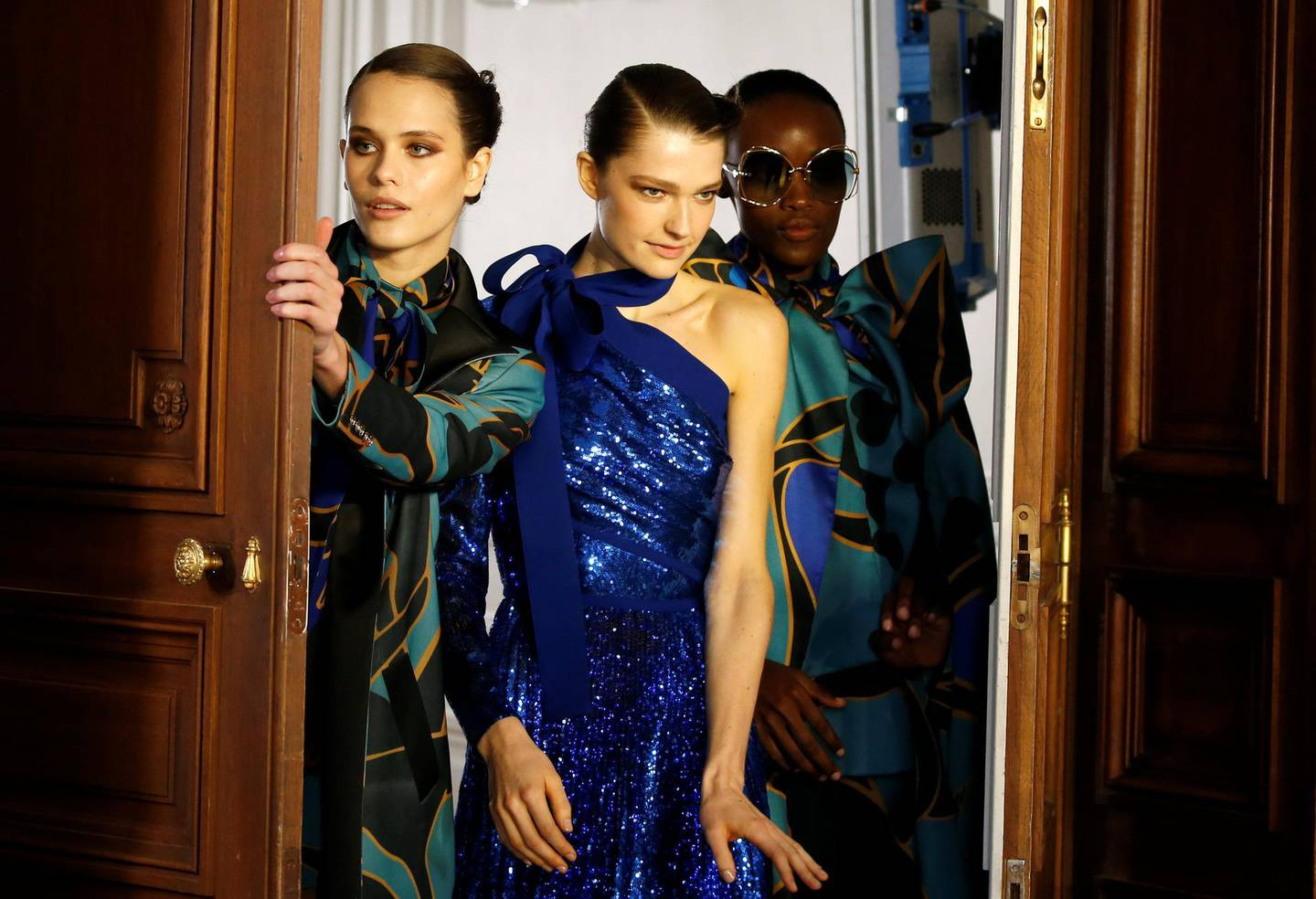 Models pose at the backstage before the show of designer Elie Saab as part of his Fall/Winter 2019-2020 women's ready-to-wear collection show during Paris Fashion Week in Paris, France, March 2, 2019. REUTERS/Regis Duvignau