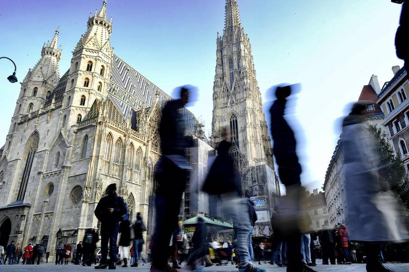 VIENNA, AUSTRIA - DECEMBER 05: Tourists walk by Domkirche St. Stephan on December 5, 2016 in Vienna, Austria. The town of Vienna is the federal capital of Austria as well as one of the nine federal states, the city has a population of 2.6 million citizens. (Photo by Alexander Koerner/Getty Images)