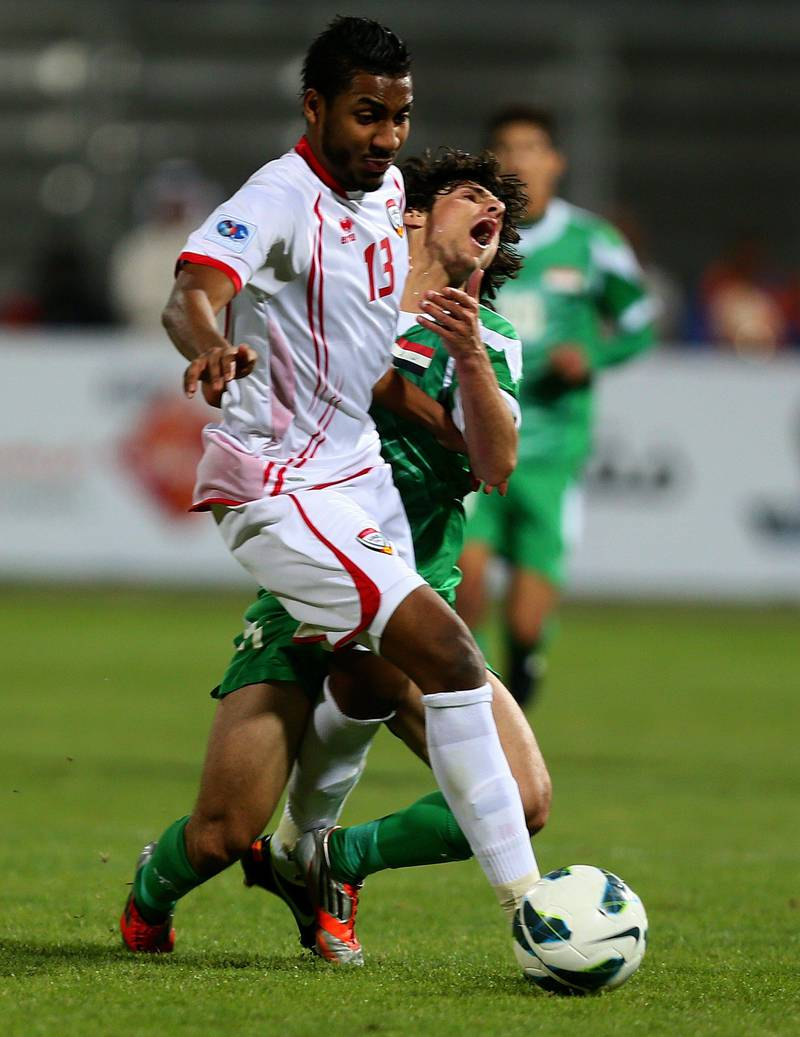 Humam Tariq Faraj (back) of Iraq vies with Khamis Ismail of UAE during the 21st Gulf Cup's final between United Arab Emirates (UAE) and Iraq on January 18, 2013 in Manama. United Arab Emirates won 2-1 against  Iraq.  AFP PHOTO/MARWAN NAAMANI  *** Local Caption ***  291315-01-08.jpg