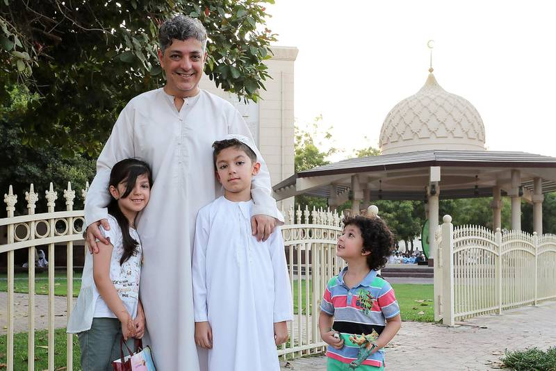 DUBAI, UNITED ARAB EMIRATES, August 21 – 2018 :- Riad Alrabie with his children Samaa ( left ), Ahmed (center) and Aws ( right ) after the Eid Al Adha prayers at the Jumeirah Mosque in Dubai. ( Pawan Singh / The National )  For News. Story by Nawal