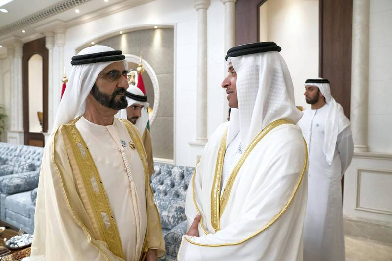 ABU DHABI, UNITED ARAB EMIRATES - June 15, 2018: HH Sheikh Mohamed bin Rashid Al Maktoum, Vice-President, Prime Minister of the UAE, Ruler of Dubai and Minister of Defence (R), speaks with HH Sheikh Hazza bin Zayed Al Nahyan, Vice Chairman of the Abu Dhabi Executive Council (R), during an Eid Al Fitr reception at Mushrif Palace.    ( Mohamed Al Hammadi / Crown Prince Court - Abu Dhabi ) ---