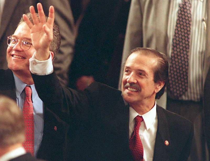 Freshman congressman Sonny Bono, R-CA, waves to the gallery around the US House chamber during the first session of the 104th Congress in Washington DC 04 January. Bono is half of the former pop/rock singing duo Sonny and Cher.  (COLOR KEY: Tie is red.) (Photo by J. DAVID AKE / AFP)