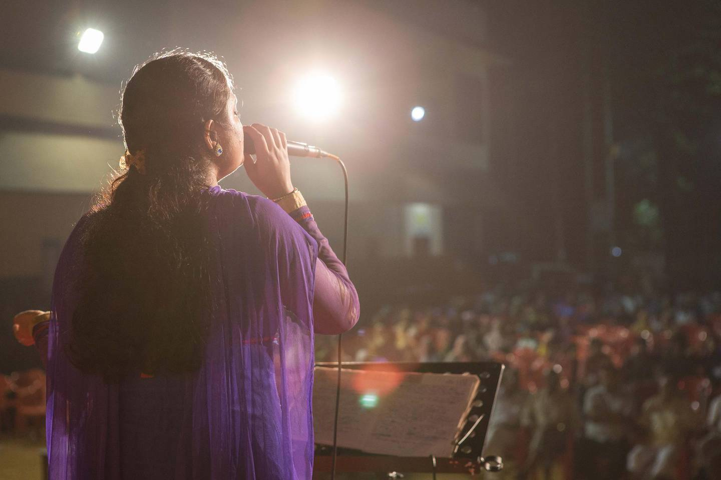 Singer Theertha Suresh performs a Kathu Pattu song for Indian villagers during a concert in Mukkam, Kerala, India. Photo by Sebastian Castelier