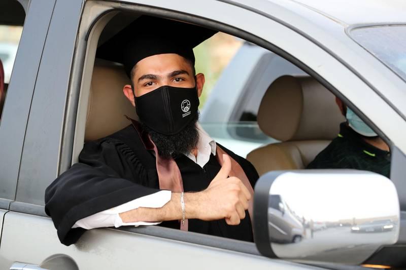 Ajman, United Arab Emirates - Reporter: Anam Rizvi. News. Khaled Hadi waits in his car before his drive through graduation from Ajman University because of Covid-19. Wednesday, February 10th, 2021. Ajman. Chris Whiteoak / The National